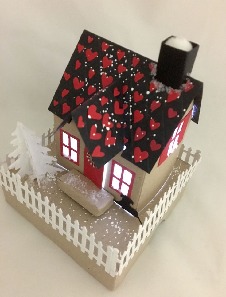 House with tealight. Card inside the box.