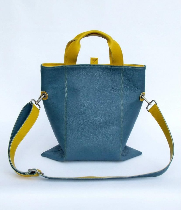 100% leather hand / shoulder bag with satin metal accessories