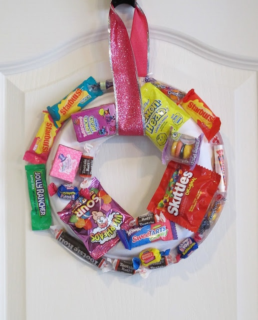 easy kid craft use leftover halloween candy to make a wreath well wed have to just make them out of candy theres no such thing as leftover candy - Halloween Candy Wreath