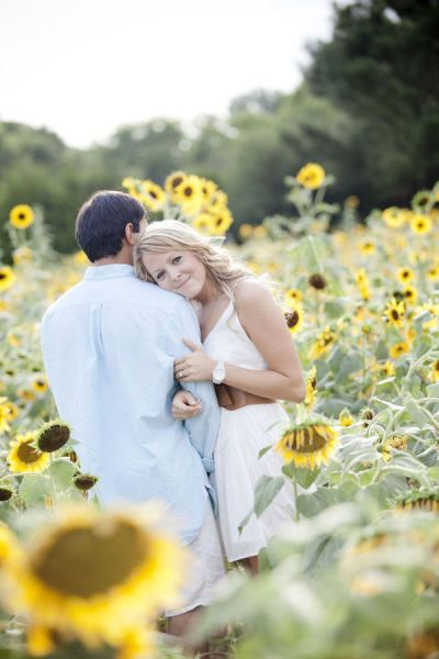 Engagement session in sunflower field...perfect!! Idk where a sunflower field is though