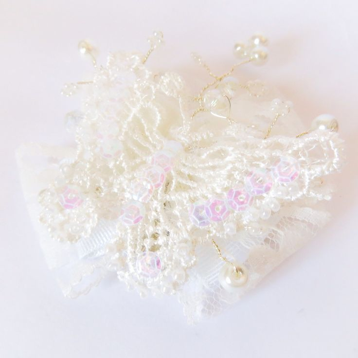A personal favorite from my Etsy shop https://www.etsy.com/uk/listing/250885368/butterfly-lace-with-pearl-vine-hair-bow