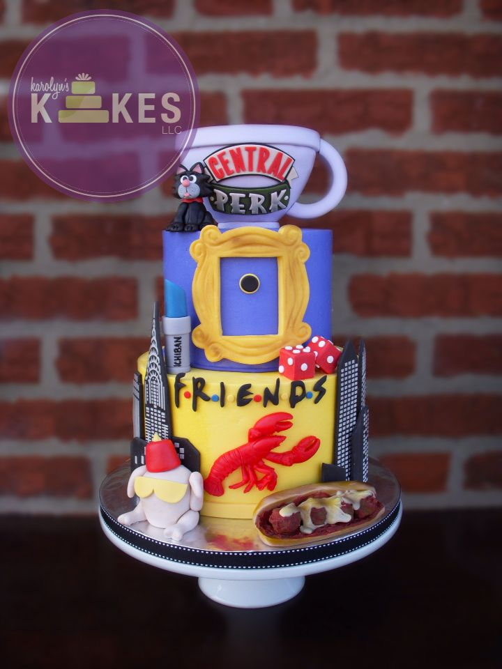 FRIENDS TV show cake! This is my absolute favorite show so I was so excited o make my 3rd one! Cakes are iced in buttercream.  Coffee cup is rice cereal. Smelly cat, turkey, meatball sub, lobster, Ichiban, dice, peep hole frame, and buildings are all marshmallow fondant.