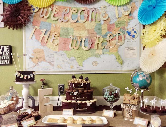 Our Welcome To The World Baby Shower! So excited to our custom font vintage map banner used in such a creative display!  Really pulls the whole thing together.   https://www.etsy.com/shop/MagpieandMax
