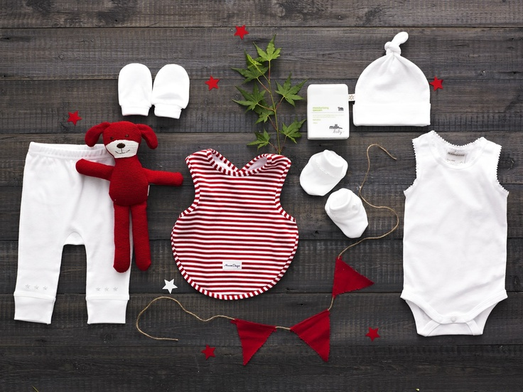 A Red Puppy-tale - $95.00  Alimrose Designs red knitted puppy rattle 30cm, Alimrose Designs arm hole back fastening red and white stripe bib, Milk Baby Moisturising Qweam 150ml, Marquise white bodysinglet, Marquise white beanie, Marquise white mittens, Marquise white booties, Marquise white legging with embroidered stars and back patch pocket www.thespecialdeliverycompany.com.au