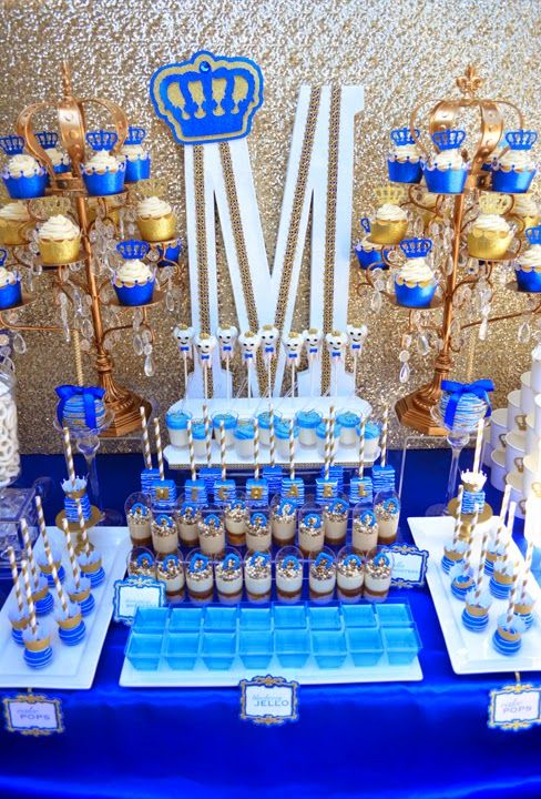 It's a ROYAL affair. A 'royal' dessert table decor with crowns, lots of gold, and yummy treats. #royaltheme #royalparty #royalblue