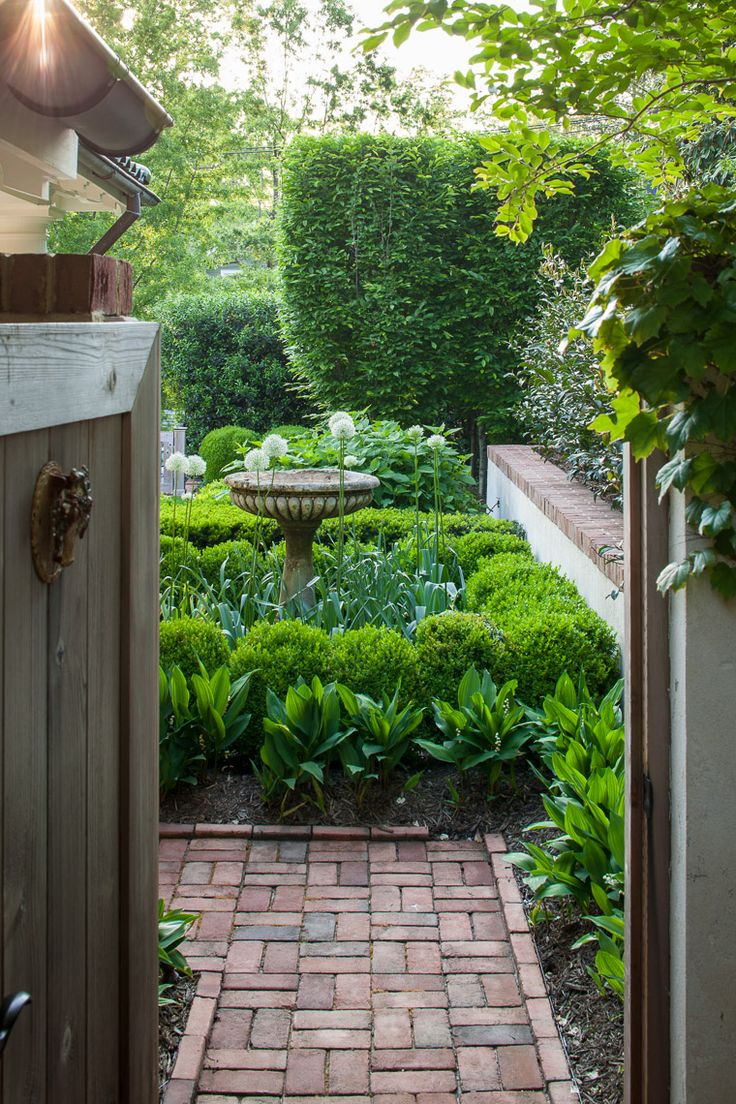 Birdbath and boxwoods.