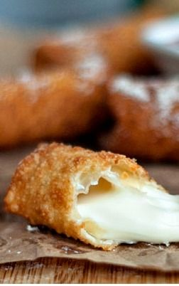 Wonton Wrapped Mozzarella Sticks. Ingredients>> 8 string cheese -- 24 wonton wrappers -- 1 egg mixed with -- 1 tbsp of water -- oil for deep-frying. Instructions. Cut cheese to length, brush wrapper w/egg wash, fold & fry. That simple. Go to web site to see step by step pics.