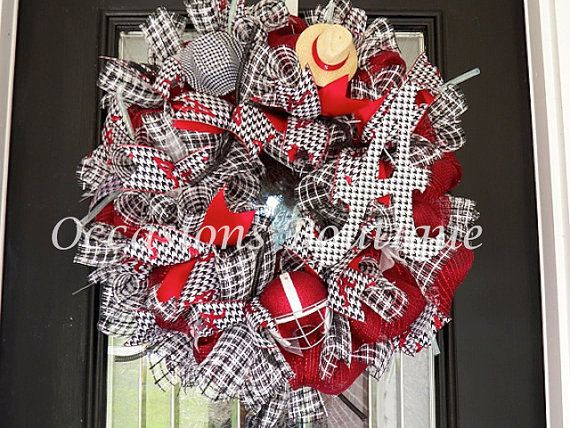 This Alabama football wreath is made with layered loops of crimson deco mesh, black and white pattern mesh spirals, wired ribbons, houndstooth A, mini houndstooth hat, mini Saban straw hat, and a glittered Alabama football helmet. The ribbons in this wreath consist of a 3-inch houndstooth print with glittered A, and a 3-inch crimson. All ribbons are wired and are easy to adjust if needed. This wreath measures approx. 27. To view all of my sports wreaths and decorations please follow this…