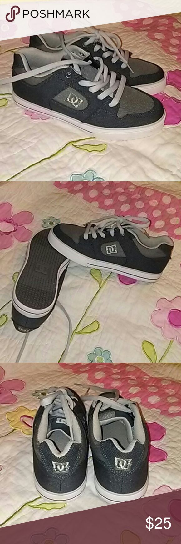 DC sneakers Never worn kids DC sneakers. They look brand new as you can see from pictures. Very nice sneaker for school or play. DC Shoes Sneakers