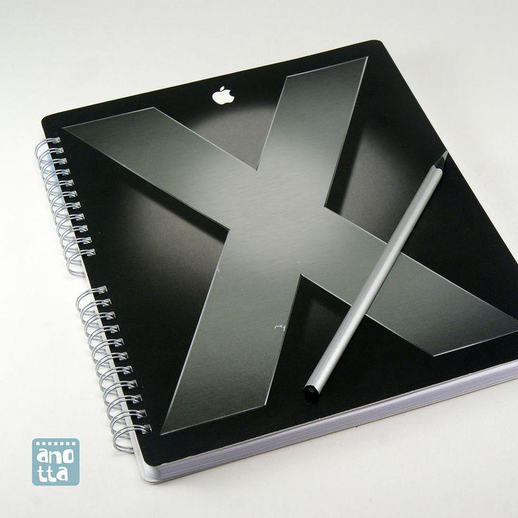 Libreta hecha a mano reciclando la caja de un sistema operativo para mac.