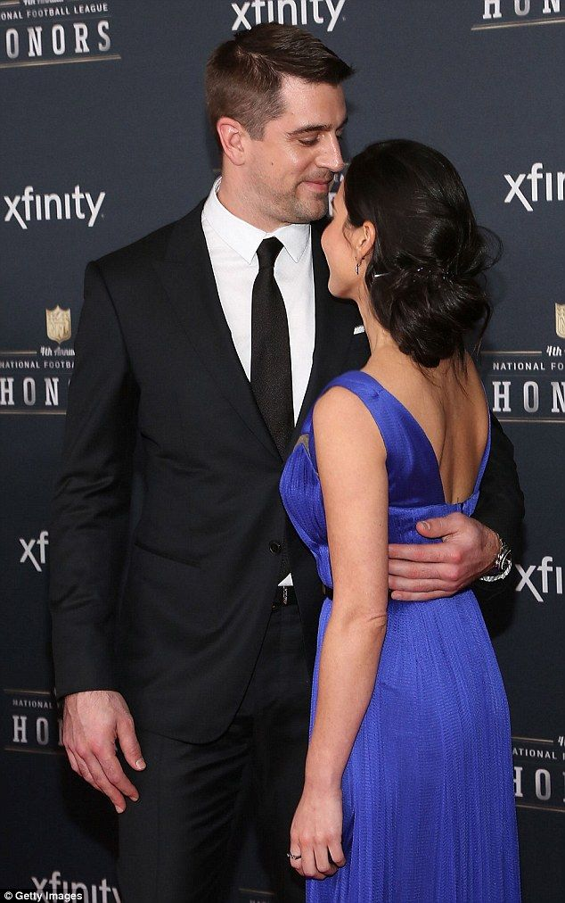 Consolation kiss: Football player Aaron Rodgers won't play in the Super Bowl, but he got named MVP by the NFL on Saturday night in Phoenix, Arizona  pictured with girlfriend Olivia Munn