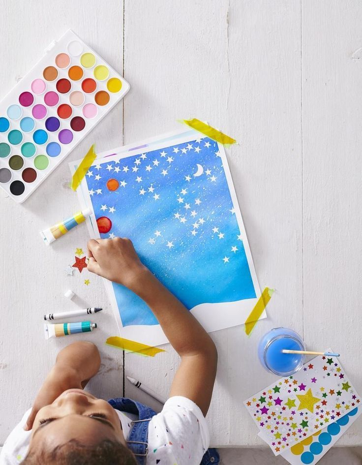 Your child will need painter's tape, watercolor paper, crayons and/or stickers, a paintbrush, and watercolor paints.