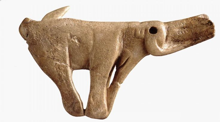 The Mammoth Spear Thrower (Circa 10,500 BCE) : Carved from an antler of a reindeer. Early example of art lending additional form or functionality to a practical object.