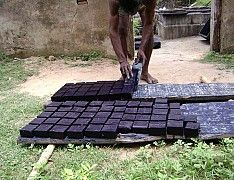 8 Putting blocks of indigo dyestuff out to dry, Tamil Nadu, India. Photo copyright Mary Lance -