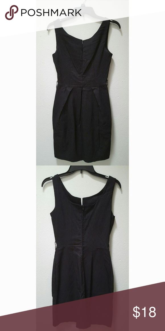 "B. Smart Pinstripe Bodycon Dress 9/10 Brand: B. Smart Size: 9/10 Color: Black with silver pinstripes Fabric: 22% nylon 69% rayon 4% polyester 5% spandex Condition: Excellent. No rips, stains, fading, piling, or other damage. Dress has small sewn in loops if you'd like to wear a belt with the dress.   Bust: 16"" across Length: 31"" center neck to hem B. Smart Dresses Mini"
