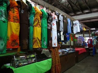 Quinn in American Samoa: Apia, Samoa | The market - gorgeous puletasi's hanging from the ceiling.