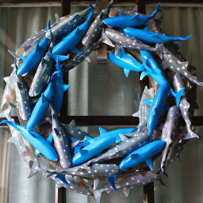 Shark wreath at a shark themed birthday party on Kara's Party Ideas! Made with plastic toy sharks. Too cute! Perfect party planning ideas :)