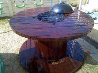 Upcycle and old wood cable reel into this BBQ table.
