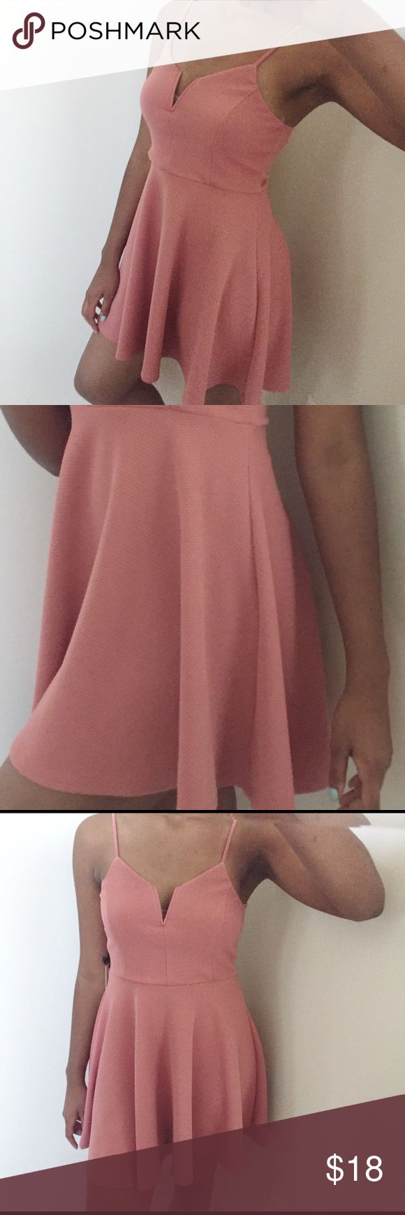 """Peach Colored Haute Monde Dress This chic mid length peach colored dress will give you a fun and cute look whether you choose to wear it for a casual sunny day or a super fun night out. The condition is new with tags but has been worn once only for photos.  Size: medium Condition: Like new with tags Color: peach Length: 34"""" Bust:35"""" Waist: 27"""" Dresses Midi"""