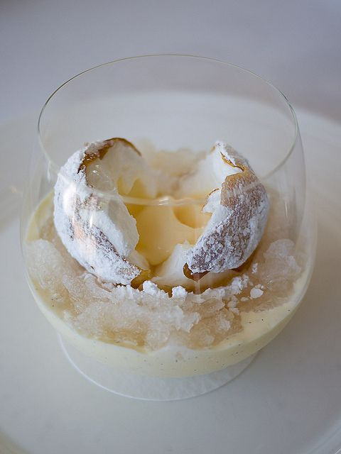 "Quay Restaurants snow egg dessert: The ""egg"" sits on a bed of white nectarine granita with white nectarine purée and custard. It has a yolk of white nectarine ice cream encased inside soft white meringue, all enclosed in a shell made from maltose tuile dusted in icing sugar. wow."