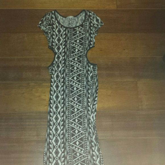 Aztec long dress Black and white Aztec dress. Open sides (show off skin) low cut on top. Goes a little below knees. Tight dress ment to show off figure (: perfect condition. Worn once. Charlotte Russe Dresses