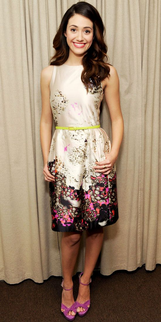Emmy Rossum struck a pose backstage at the Rachael Ray Show in a floral Schumacher print dress and fuchsia heels.