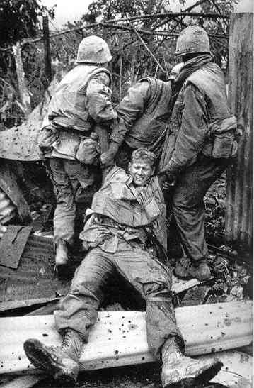 U.S. soldiers near Hue dragging a wounded comrade to safety
