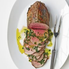 Rare Roast Beef with Fresh Herbs and Basil Oil - This rosy roast beef with basil oil seems decadent but contains only two grams of saturated fat per serving. www.foodandwine.com/recipes/rare-roast-beef-fresh-herbs-and-basil-oil