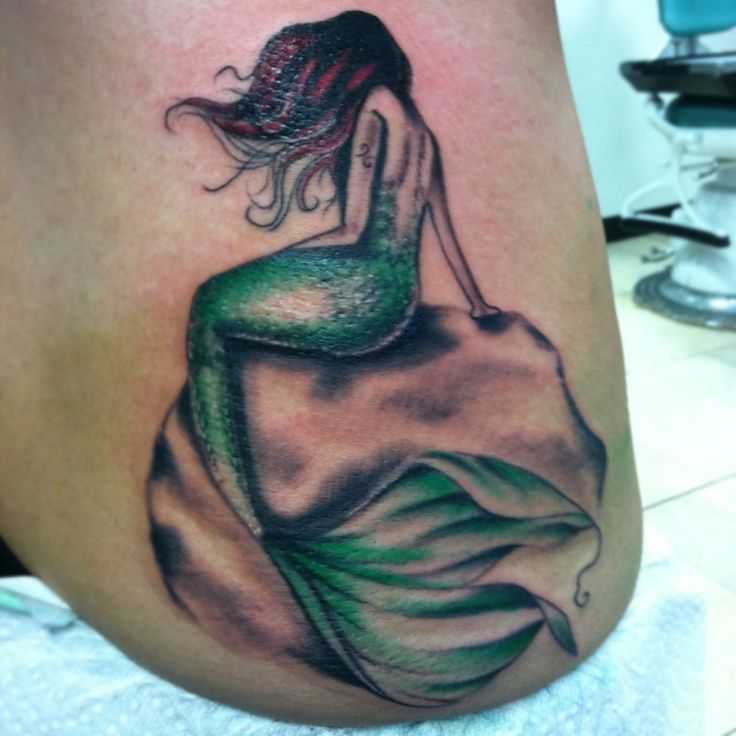 This is a nice mermaid tattoo. It would also look great with some water or waves!