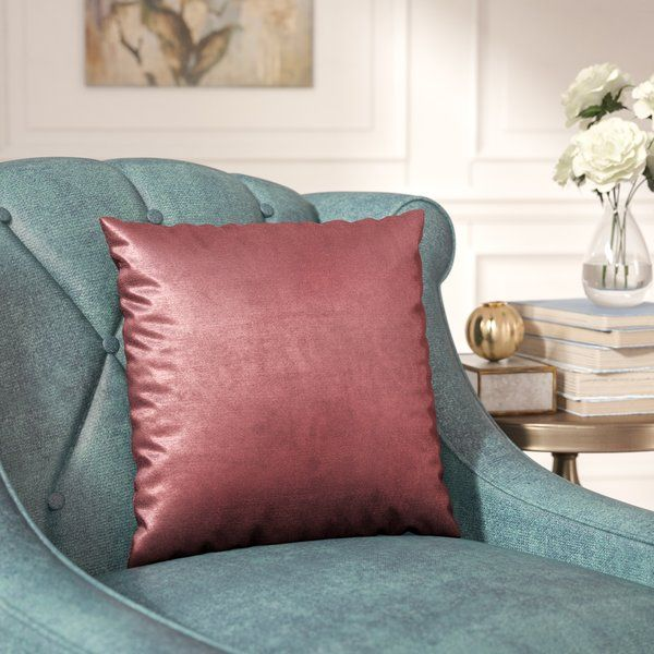 Spruce up a seat in the living room ensemble or lend a dash of distinction to your restful retreat in the master suite with this posh pillow. Crafted from polyester inside and out, it takes on a square silhouette while the cover offers a solid jewel-toned design. Simple as it may seem, this accent is eye-catching shining solo or paired with a lush fur blanket to really draw the eye.