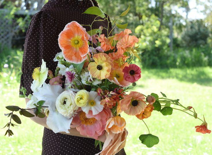 october flowers, bridal bouquet, spring flowers, coral peony, poppies, ranunculus, nasturtium, columbine, bearded iris, sherbet tones, orange, creamy yellow, white, ivory, spring wedding, silk ribbon