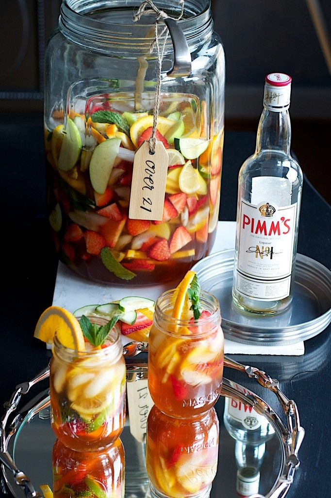 Pimms No.1 Sangria Cocktail - This is a twist on a traditional Pimm's cocktail which is served at The Napoleon House in New Orleans and is a Mardi Gras tradition. Nothing says it's party time like a big pitcher of sangria stuffed with colorful fruit! This recipe combines the two recipes into one magical drink fit for a Mardi Gras celebration. | New South Food Co.