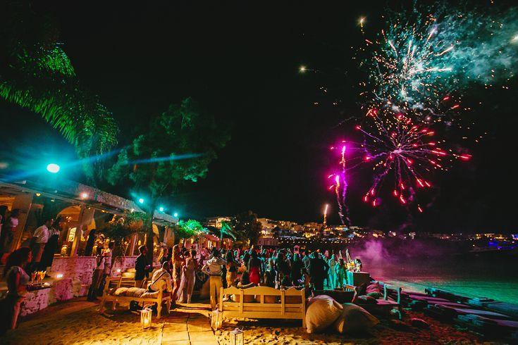 Mykonos Exclusive weddings..  Fireworks at nammos beach front restaurant for George & Caren