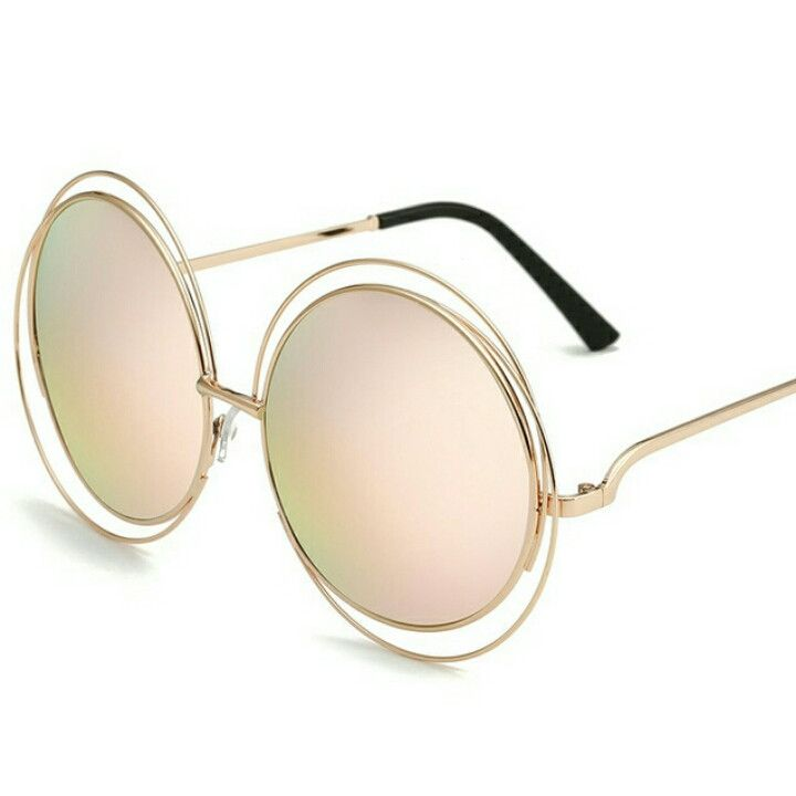 Studio covered side round silhouette sunglasses featuring a metal outer frame. They feature a unique etched edge around the lenses and a beautiful color mirrored lens. A wonderful piece for anyone loo