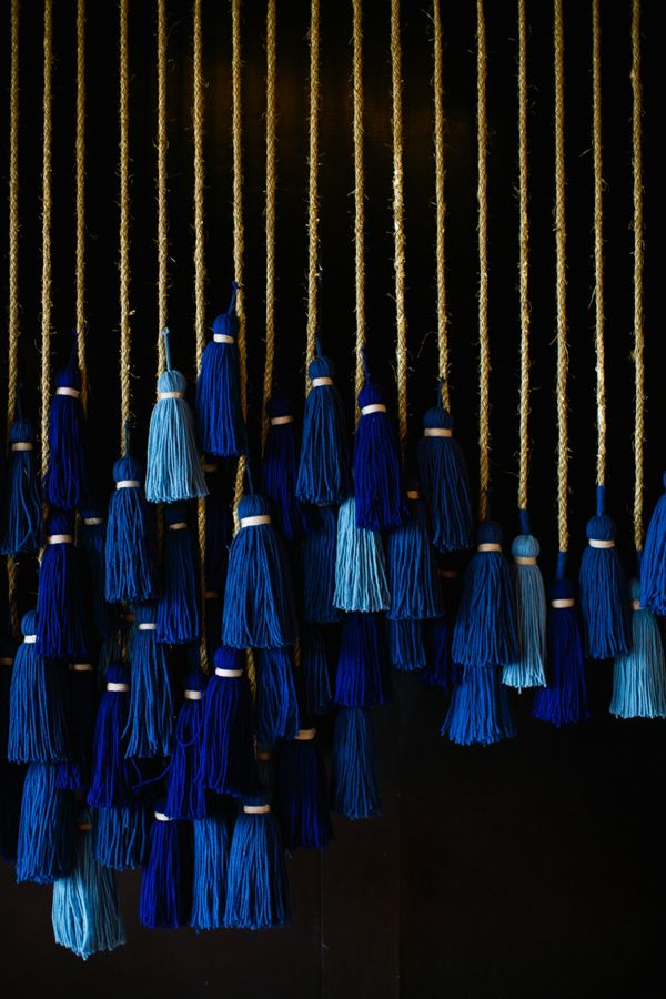 midnight blue tassels - photo by Anna Naphtali http://ruffledblog.com/bohemian-nouvea-wedding-with-midnight-blue
