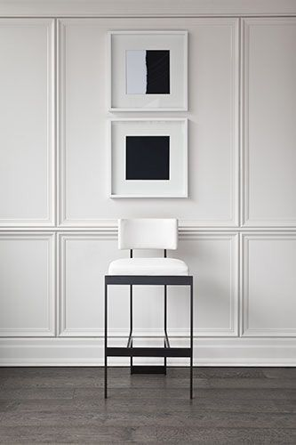 Beautifully detailed wall paneling reads contemporary yet classic.