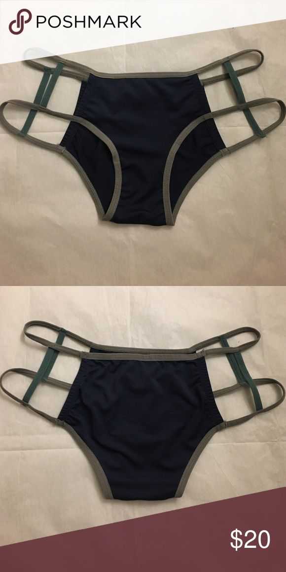 Urban Outfitters Bikini Bottom Urban Outfitters Cut-Out Side Bikini Bottom • Size S (true to size) • Navy/grey/dark turquoise • Used once // Very trendy bikini bottoms with completely open sides, but full coverage! Urban Outfitters Swim Bikinis