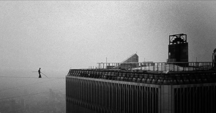 Phillippe Petit walks between the Twin Towers in 1974
