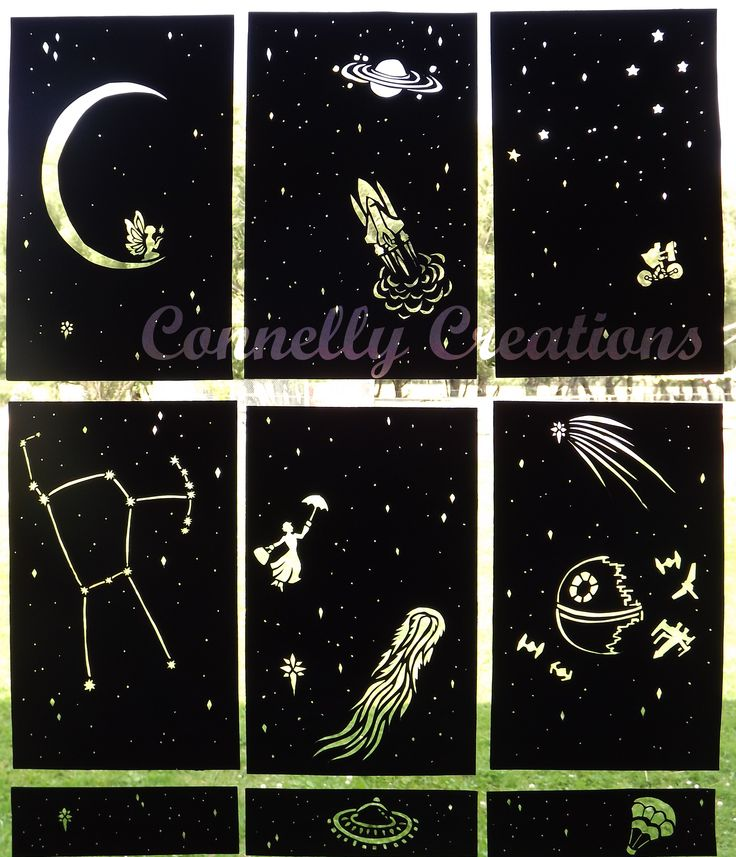 Black paper night sky inserts for the window in the classroom night-time reading nook
