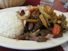 Lomo Saltado Recipe (Peruvian beef and potato stir fry) this meal never gets old! Always serve this with the Aji Sauce and white rice!