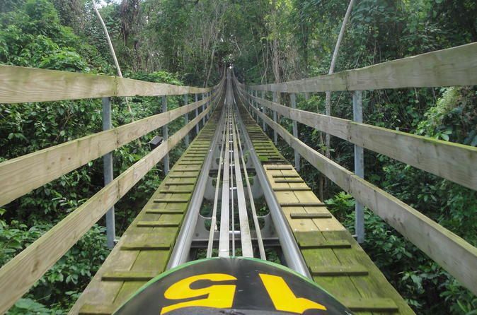 Mystic Mountain Jamaica Bobsled from Ocho Rios Hold onto your hat: this is one wild ride! Inspired by the famous Jamaican bobsled Olympic team, the bobsled ride at Mystic Mountain Jamaica near Dunn's River Falls is the park's signature attraction.Start your bobsledding adventure with pickup from your lodging in Ocho Rios or the cruise port.  Upon arrival, take in the impressive bobsled track, inspired by the 1998 movieCool Runningsand built in the surrounding rainforest with...