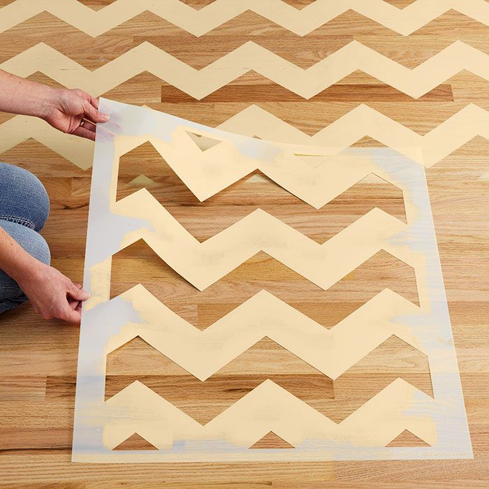 Add custom color and bold patterns to a wood or other hard-surface floor with dramatic chevrons you can stencil in a weekend.