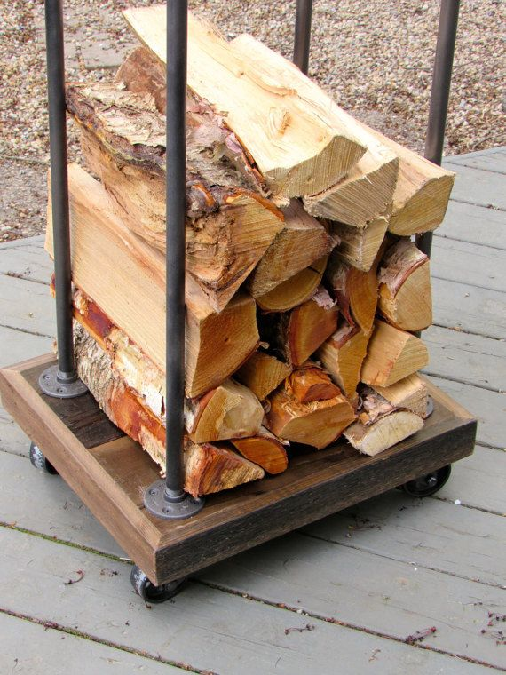 Rustic Firewood Rack for neatly stacking your logs for burning. Perfect for the hearth or fireplace, this piece is finished in a rustic/industrial style using cedar and metal pipe fittings. The Rack measures 17 x 20 at the base and stands 43 tall. It is fitted with 3 metal casters for added mobility and industrial style. Made to order.  Assembly required.