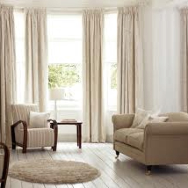Tall bay windows curtain ideas (not the color, but you can see that it still allows plenty of light)