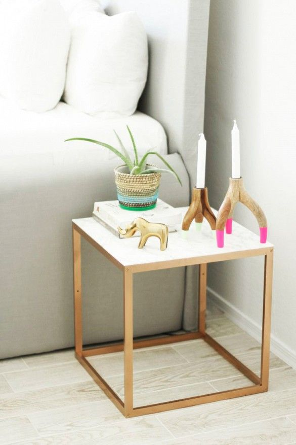 Take one square side table, add contact paper, spray-paint, and—nope, that's it… You'll be left with a seriously chic piece.- 13 Chic IKEA Hacks for Your First Apartment via @mydomaine