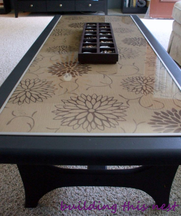 Our current coffee table is a hand-me-down from my parents. In it's previous life, it was a lighter coloured wood and my mom had put a patterned paper underneath the glass top. That was actually it...