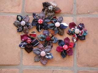Rickrackruby on Craftster used the tips of old neckties to create these cute flower pins. Link.
