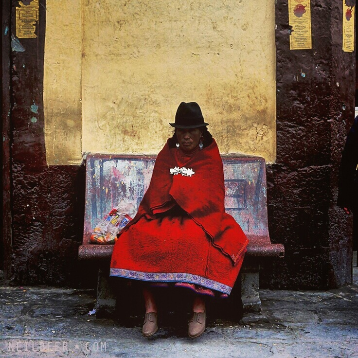 Ecuador   Woman waits at station    www.neilbeer.com