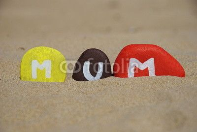 Mum, mother on colourful stones over the sand