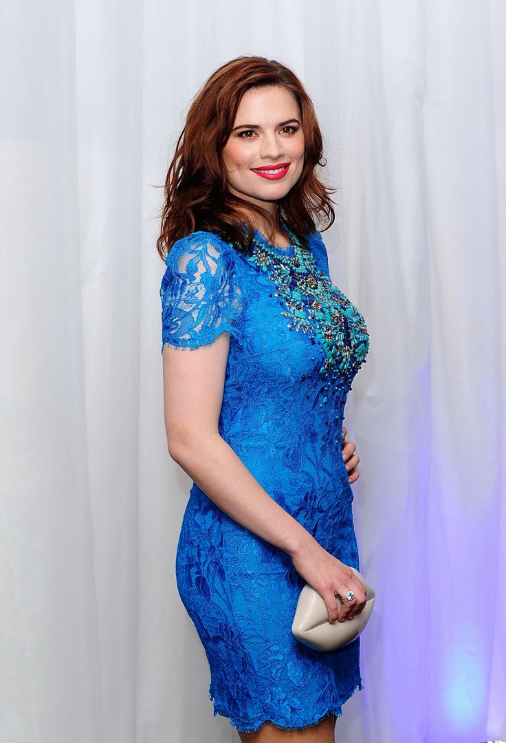 Hayley Atwell in a curve hugging blue mini dress